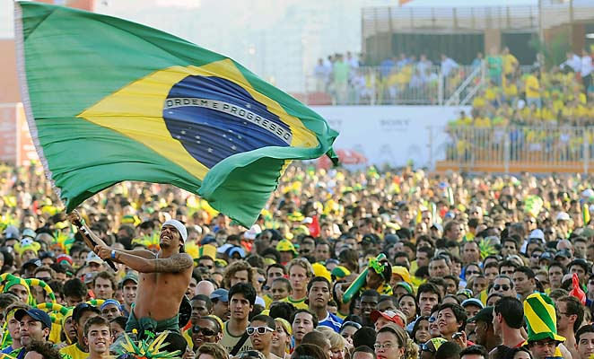 A Brazilian fan waves the national flag